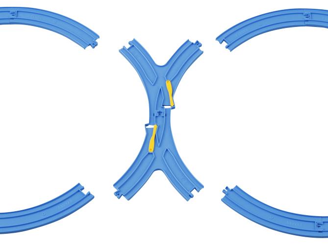 首先将8字的交叉口轨道连接,连接时交叉口的切换装置不能偏向左或右的一侧,要点是相对应的切换设置避免只跑一侧。